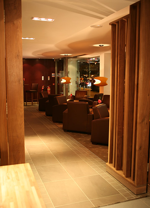 hotel bar seating area corridor with wooden partitions