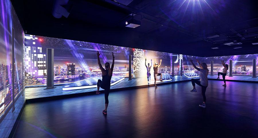luxury fitness studio with dynamic lighting