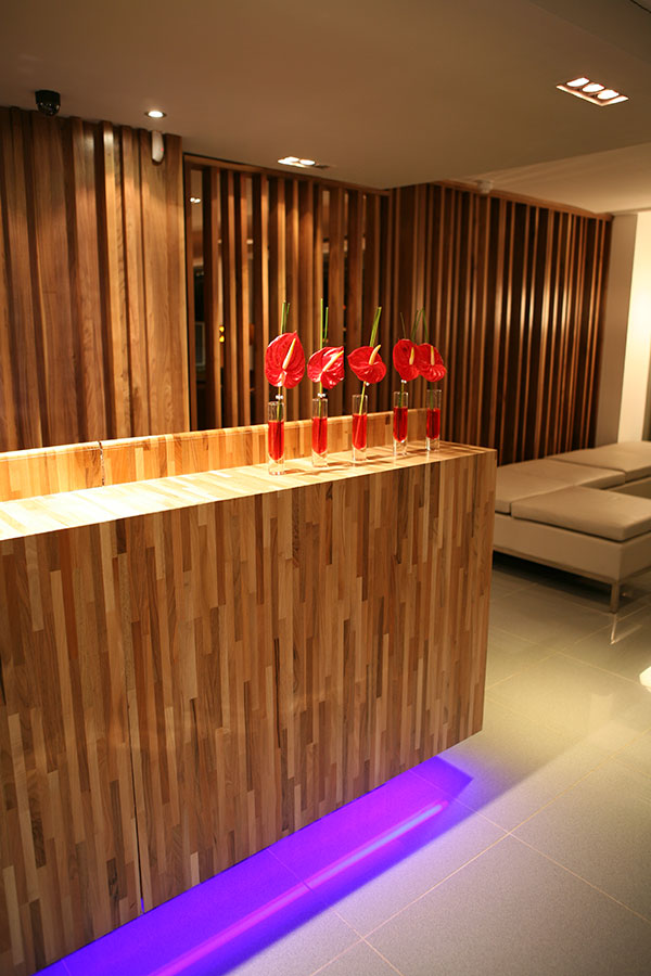 hotel gym reception area with red plants