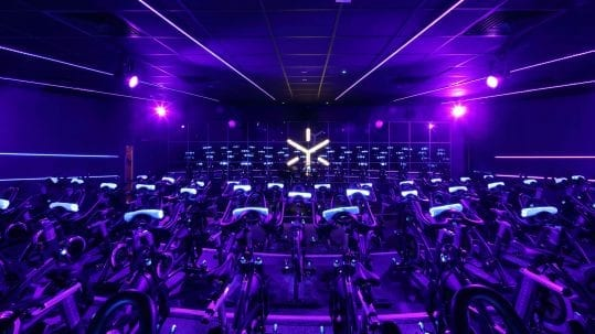 spin studio with purple lighting