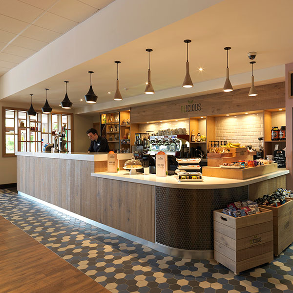 wood based cafe counter area with food and drink