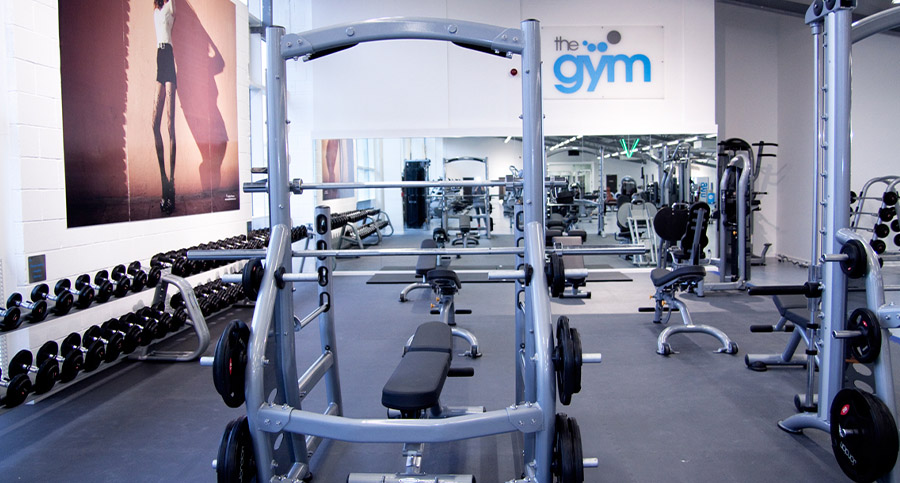 weight lifting bench and weights in a large gym design