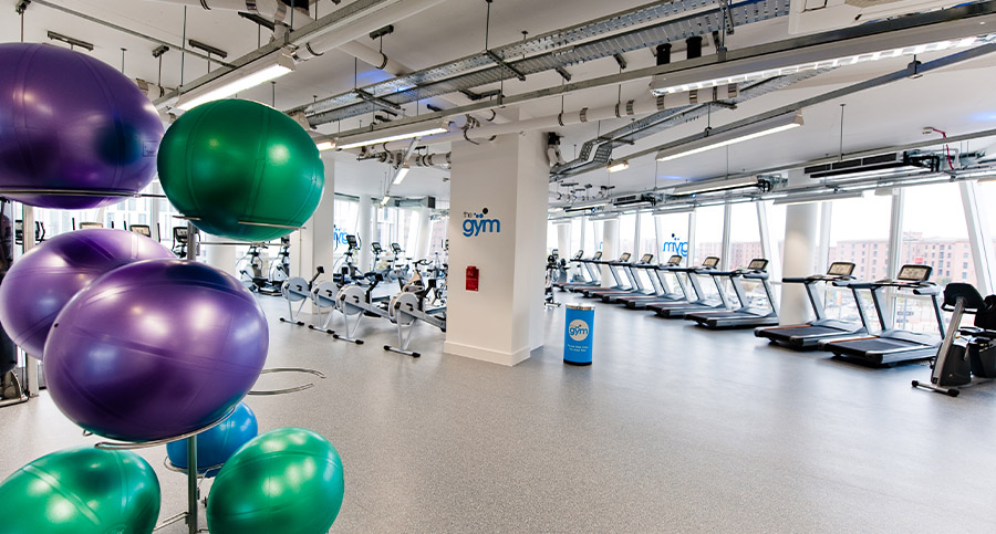 rack of fitness balls in a large gym design