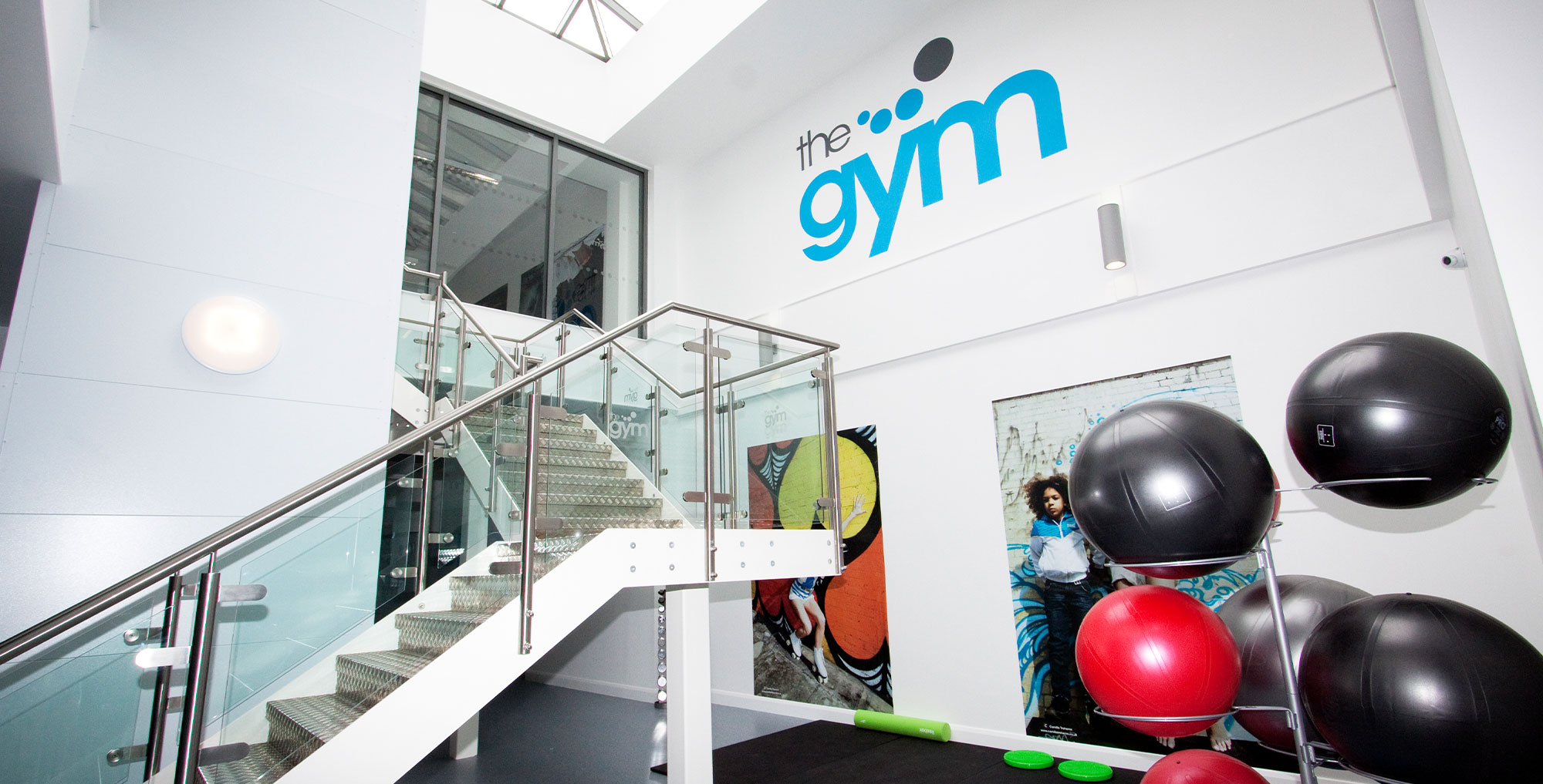 fitness balls below a staircase in a gym design
