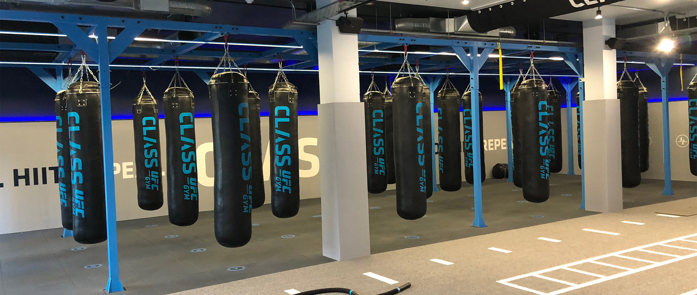 large gym room with punchbags