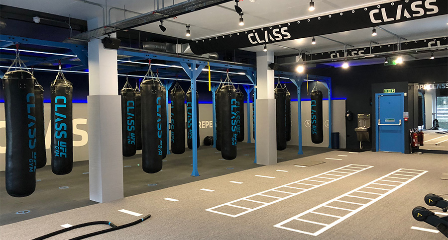 crossfit area of gym with punchbags and training area