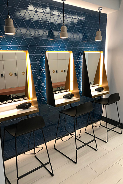 hairdryers and mirrors in gym changing room