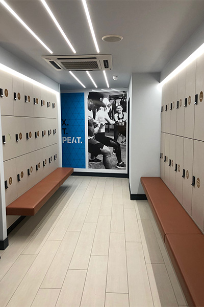 gym locker room with ceiling lights