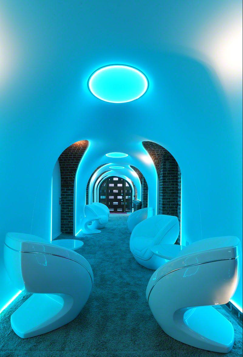 spa equipment in a blue lit corridor